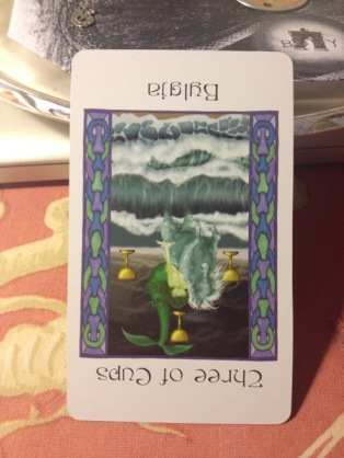3 of Cups reversed (the Undine Bylgia) holds onto the tail of the snake, keeping Her from moving forward